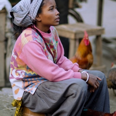 woman selling roosters 2